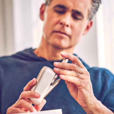 Person holding an IQOS device.